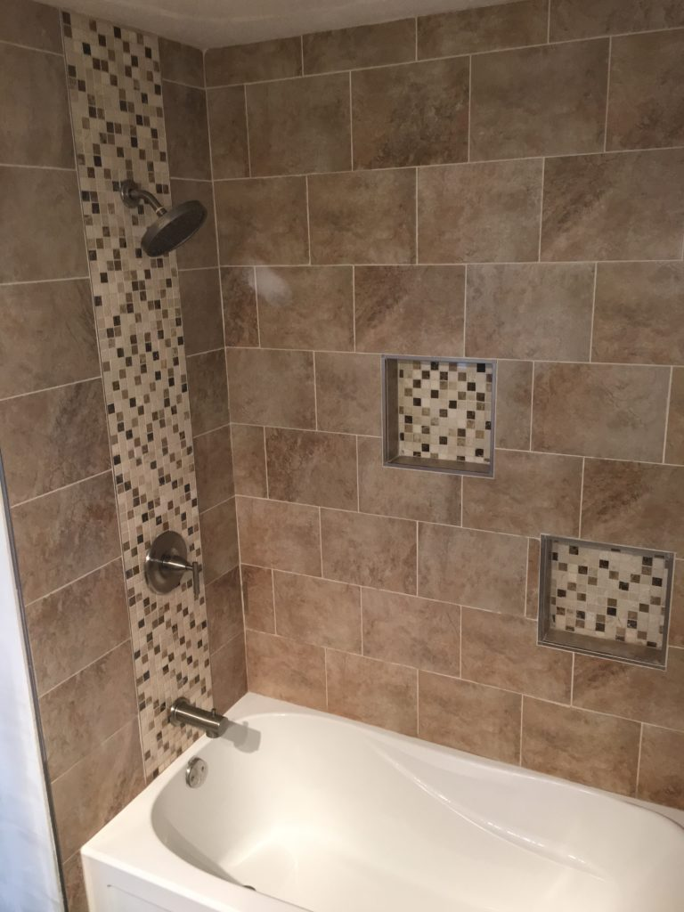 Two different types of tile work in a shower.