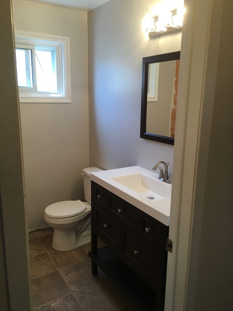 Newly finished bathroom with a new vanity.