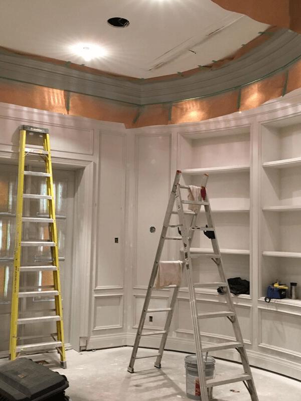 White painted shelving in a new building.