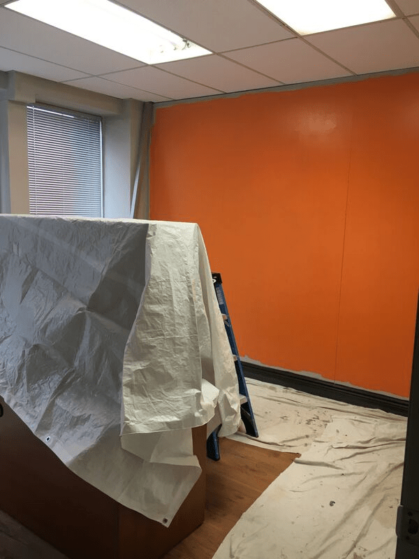 Freshly painted orange wall in an office building.