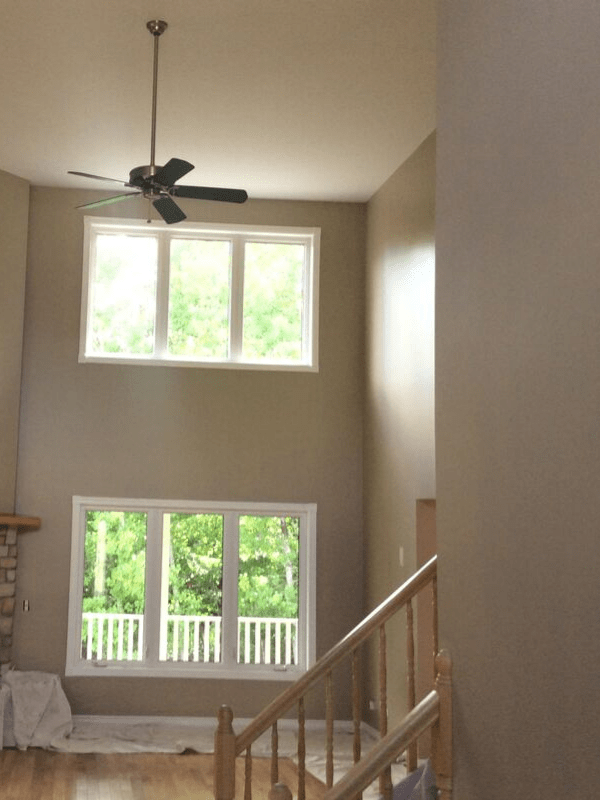 A high ceiling living room with freshly painted walls.