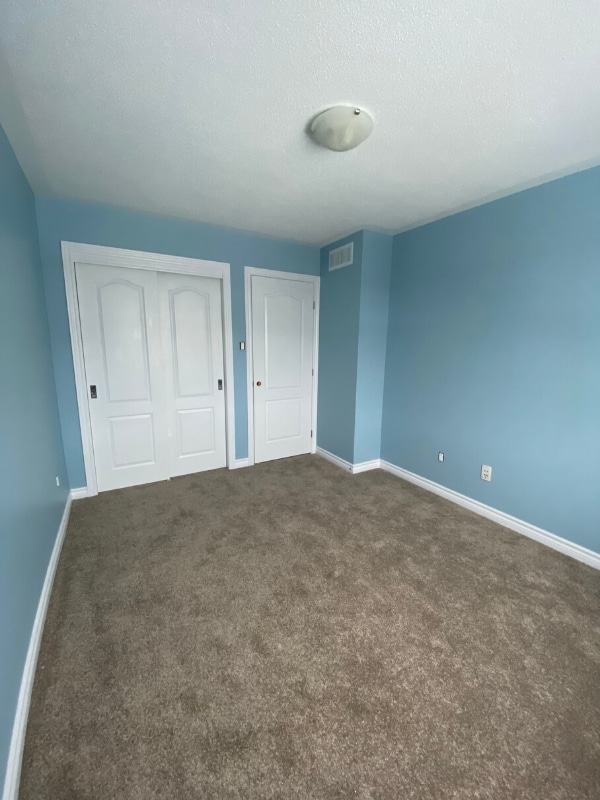 Freshly painted light blue walls with white doors and molding.
