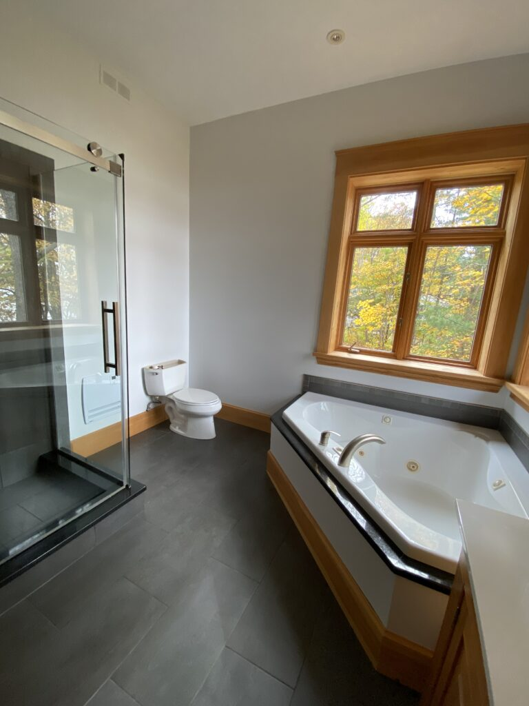 A luxurious bathroom with freshly painted walls.
