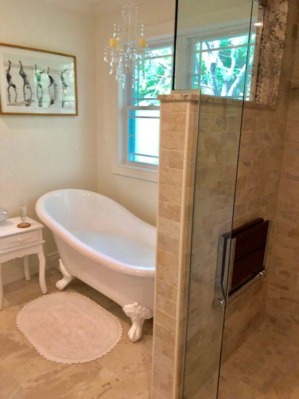 Recently finished bathroom with a claw-foot bathtub.