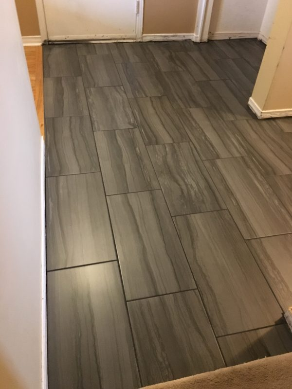 Newly laid tile flooring in a hallway.