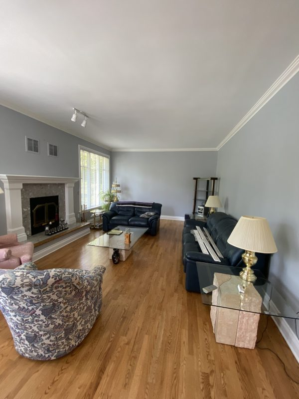 Freshly painted light grey walls with crown molding.